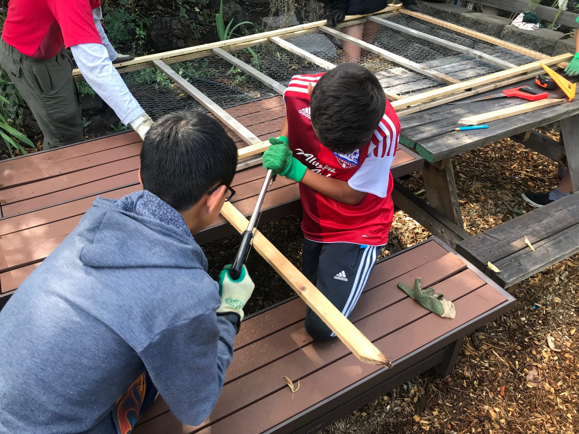 kids building trellis
